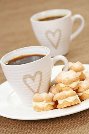 two cups of coffee and delicious cookies Stock Photo - 4131814