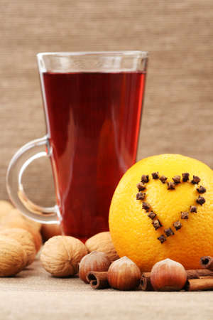 redwine: glass of hot wine with orange and spices