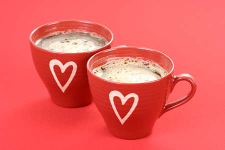 two cups of coffee on red background - food and drink Stock Photo - 4131890