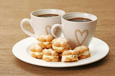 two cups of coffee and delicious cookies Stock Photo - 4163113