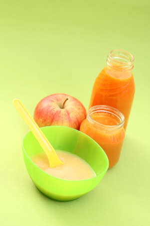 bottle of juice and jar of porridge - baby food Stock Photo