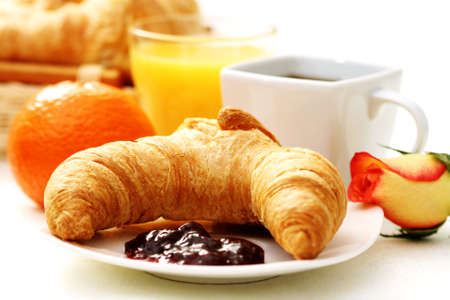 butter croissant and coffee for breakfast - food and drink photo