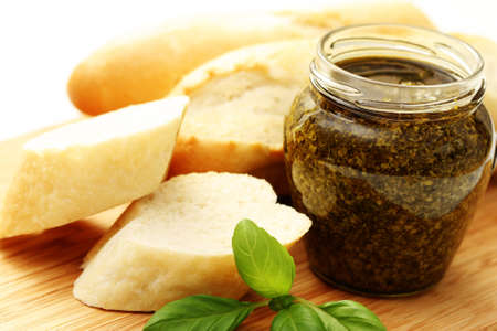 baguette and jar of pesto - delicious snack - food and drink photo