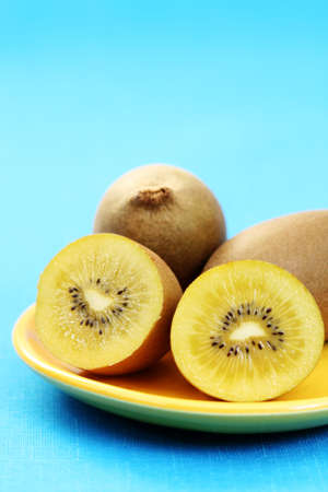 closeups: plate of golden kiwi - fruits and vegetables Stock Photo