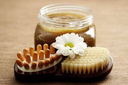 scrub: jar of body scrub and massager - beauty treatment Stock Photo