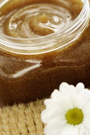 jar of body scrub and massager - beauty treatment Stock Photo - 4452404