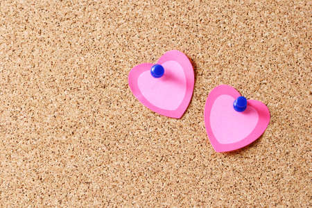 cork board with blank hearts - Valentine Day photo