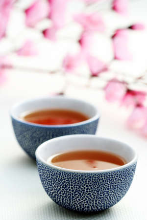 afternoon break: two cups of tea with pink flowers - food and drink