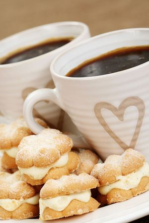two cups of coffee and delicious cookies Stock Photo - 4603977
