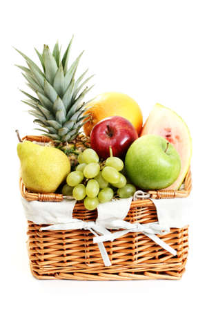 picnic basket full of delicious fruits isolated on white photo