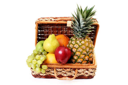 picnic basket full of delicious fruits isolated on white Stock Photo - 4951137