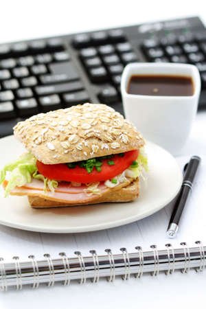 quick lunch in the office - bun and cup of coffee