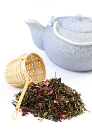 pile of white tea with rose petals on white - tea time Stock Photo - 5050887
