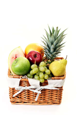 picnic basket full of delicious fruits isolated on white Stock Photo - 5050877