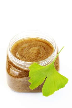 body scrub: jar of body scrub on white - beauty treatment