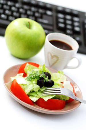 green office: healthy snack in the office - plate of fresh salad