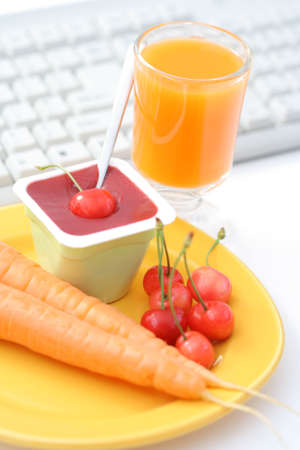healthy snack in the office - yogurt and fresh fruits and vegetables photo
