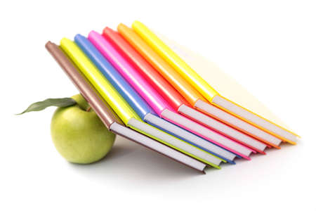 stack of books with green apple - back to school Stock Photo - 5279563