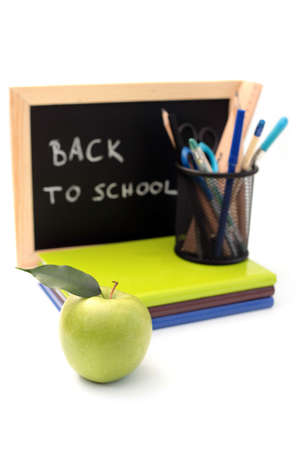 green apple: blackboard and chalk with green apple - back to school
