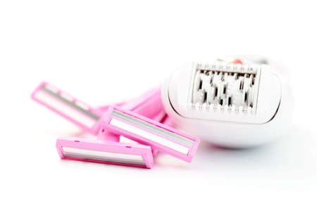 pink razor and epilator on white - beauty treatment focus on razor photo