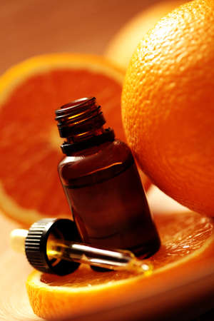 bottle of essential oil from oranges - alternative medicine photo