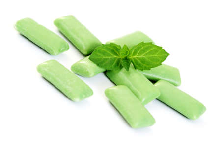 spearmint: chewing gum with fresh spearmint on white