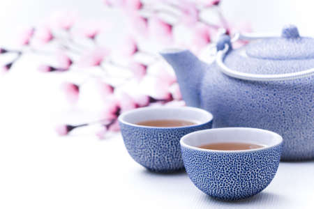 two cups of tea with pink flowers - food and drink Stock Photo - 5354564