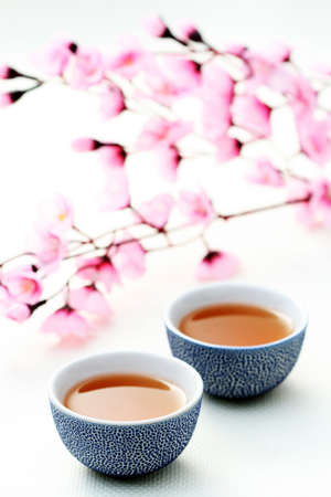 two cups of tea with pink flowers - food and drink Stock Photo - 5354565