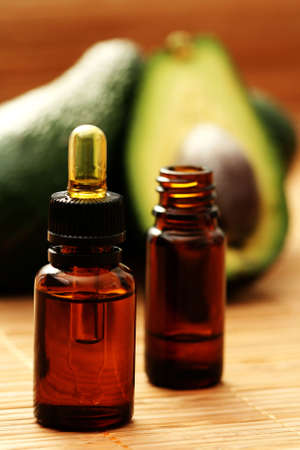 avocados: bottle of avocado essential oil - beauty treatment