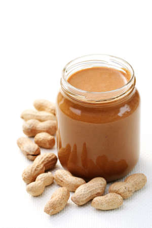 jar of peanut butter on white - food and drink photo