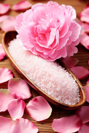bowl of pink bath salt with pink rose - beauty treatment photo