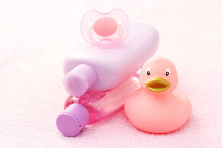accessories for baby bath on pink towel - body care photo