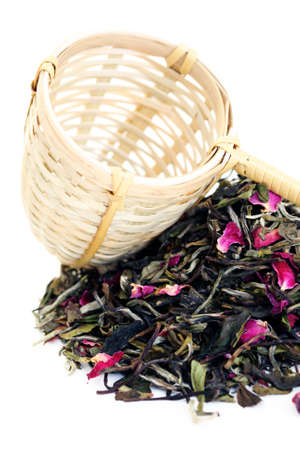 pile of white tea with rose petals on white - tea time photo