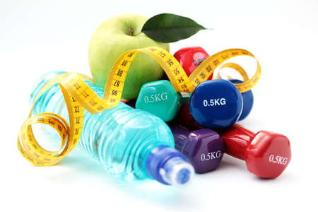 weight weightlifting: colorful dumbbells on white background - sport and fitness