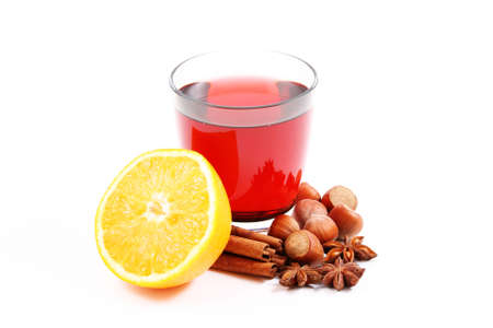 glass of hot wine and various spices on white - food and drink photo