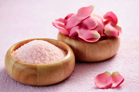 bowl of pink bath salt with pink rose petals - beauty treatment photo
