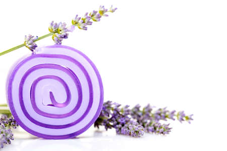 grooming product: lavender glycerin soap with fresh flowers - beauty treatment Stock Photo