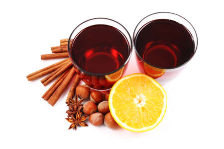 two glasses of hot wine and various spices on white - food and drink photo
