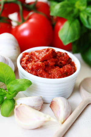bowl of tomato sauce with herbs - food and drink photo