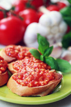 plate of delicious bruschetta and fresh ingredients - food and drink photo