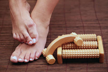 feet and wooden massager - beauty treatment Stock Photo - 5669850