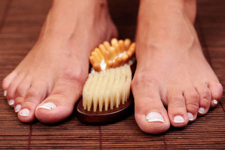 feet and wooden massager - beauty treatment Stock Photo - 5669861