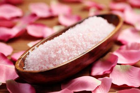 bowl of pink bath salt with pink rose petals - beauty treatment photo