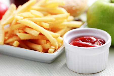 fried snack: french fries and some apple- food and drink