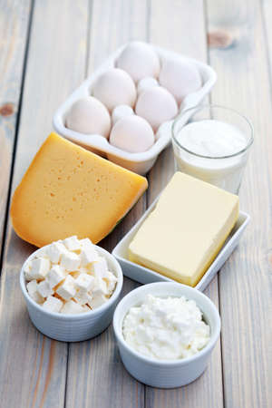 feta: diary products on wooden table - food and drink Stock Photo