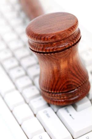 defendant: judges courtroom gavel on computer keyboard Stock Photo