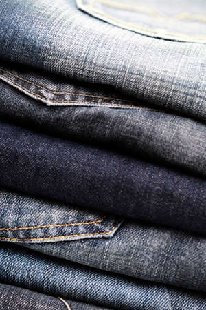 close-ups of stack of blue jeans photo