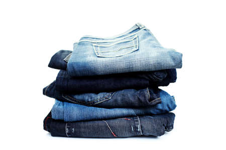 stack of blue jeans on white background photo