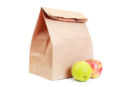 apple sack: paper lunch bag with fresh apples on white - food and drink