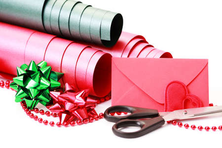 Gift wrapping materials on white background photo